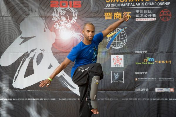 Competitor of The US Open Martial Arts Championship posing for a picture